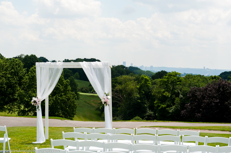 summer wedding, ceremony, white chairs, sunny day, altar, whispy canopy