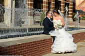the bride and groom share a moment at Duquesne University at the water fountain
