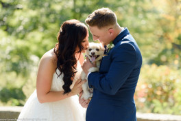 The bride kisses her dog at Point State Park in Pittsburgh, Pennsylvania