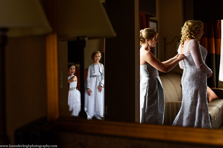 The excitement the flower girls have at seeing the bride in her wedding gown.