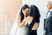 The bride cries when she turns around to show herself in her dress to her mother.