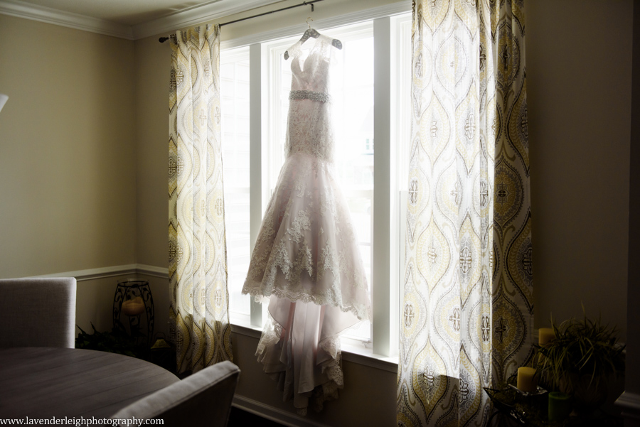 Lace Wedding Dress Hanging in Window by Lavender Leigh Photograhy